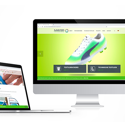 Website der Textildruckerei Mayer auf verschiedenen Displays